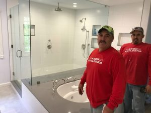 construction workers finishing bathroom remodel