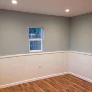 white wainscott in bedroom and