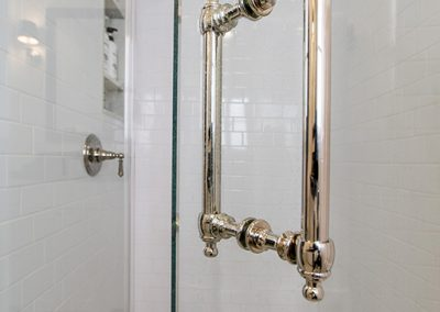 walk-in glass shower brass-hardware