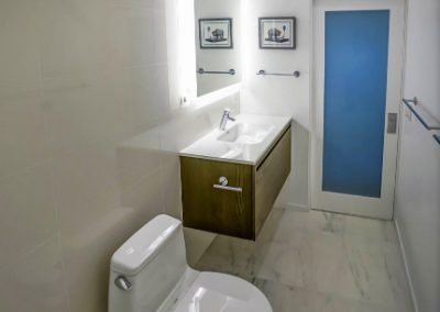 santa-monica-condo-bathroom-glass-door-marble-floor