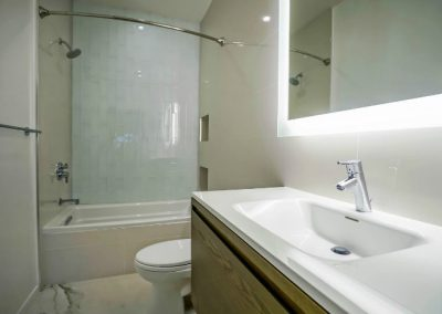 santa-monica-condo-bathroom-sink-close-mirror-light