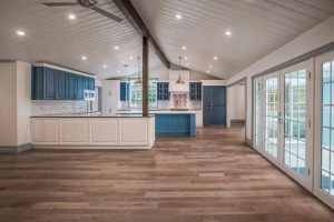 ighe end blue kitchen in pasadena with wood floors