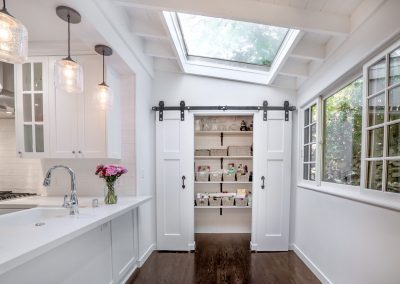 skylight and kitchen food pantry with barn doors
