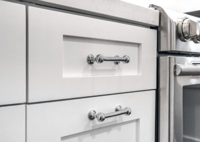 white-kitchen-cabinet-steel-pulls