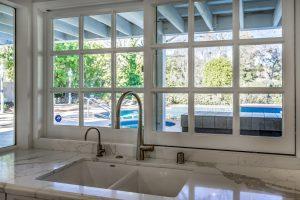 Tarzana white marble kitchen with window