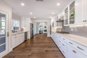 Long narrow kitchen remodel with distressed wood floors