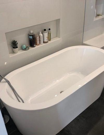 built in shelves over the tub