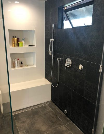 Shower with built-in seat bench