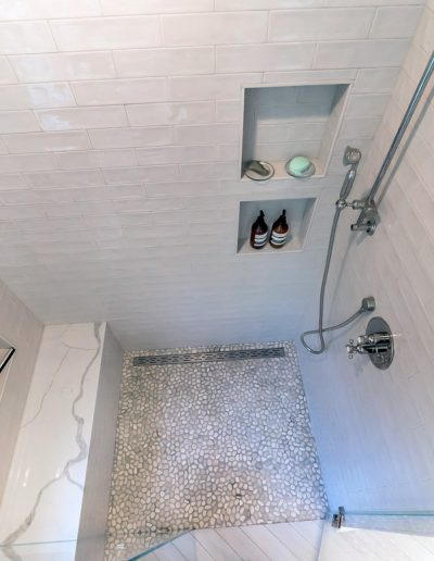 shower tile and built-in shelving