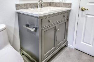 metallic grey bathrrom vanity with toilet roll holder on the side