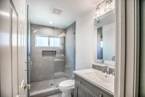 new shower remodel, toilet, vanity, mirror and fixtures