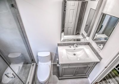 modern toilet and vanity in upgraded bathroom in Calabasas, California