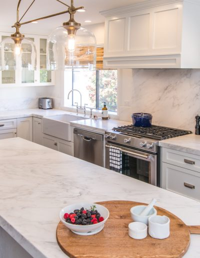 stainless steel appliances and marble backsplash in new kitchen remodel Pacific Palisades