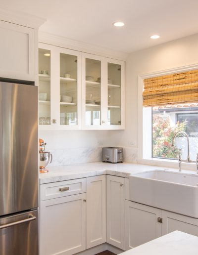 natural light through new windows and open glass white kitchen cabinets