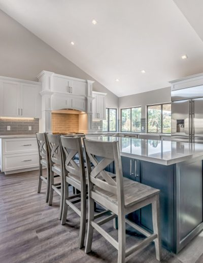 Thousand Oak large white kitchen with grey island with marble countertop