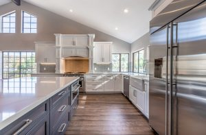 white cabinets with white marble countertop and grey cabinet island